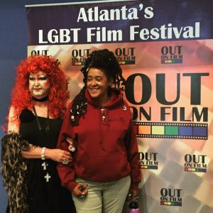 Drag performer Lily White and spoken word artist Theresa Davis.