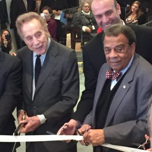 John Portman and Andrew Young, who both have streets named for them at Peachtree Center help cut the ribbon at the grand reopening of 230 Peachtree.