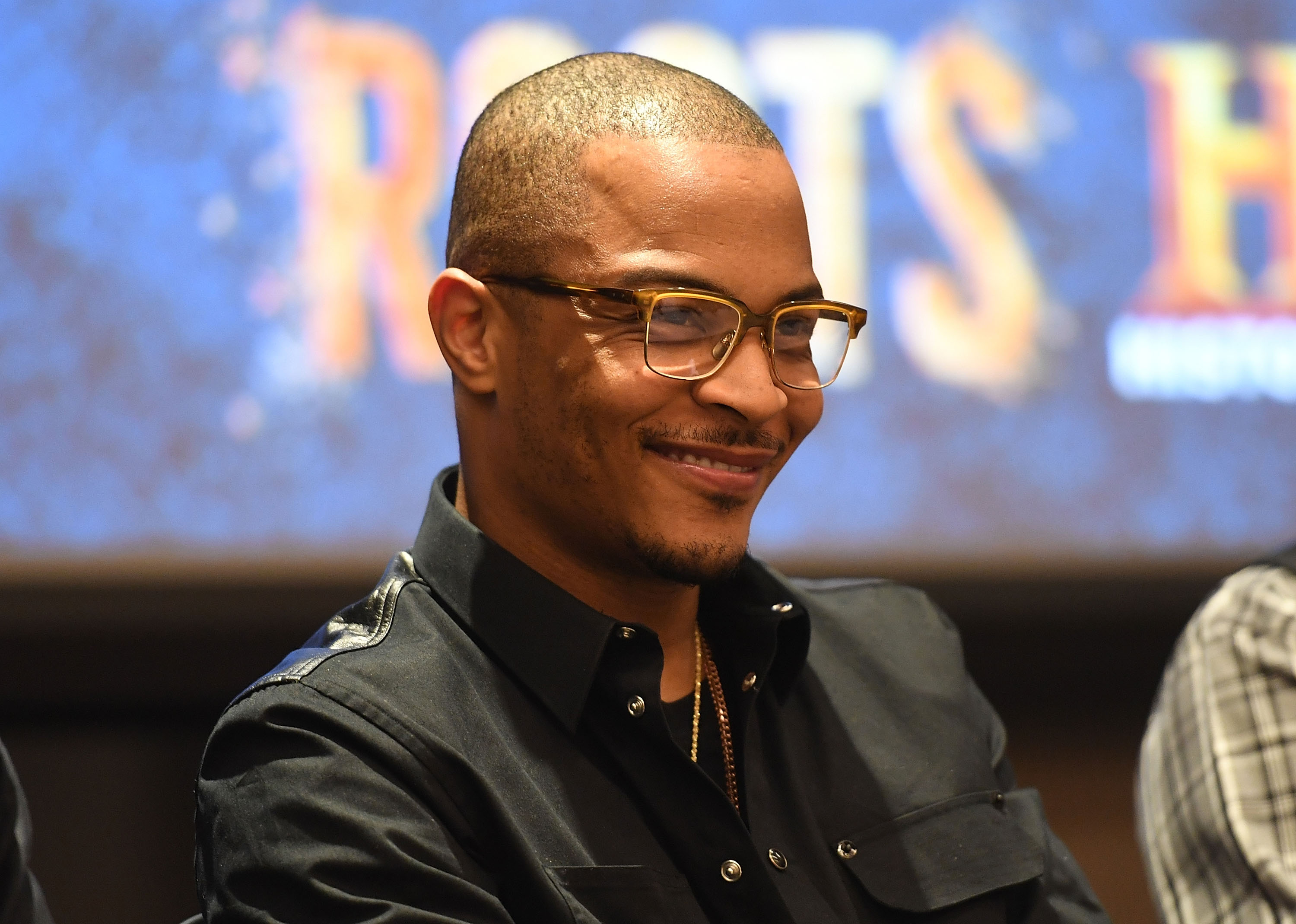 """ATLANTA, GA - MAY 09:  Actor/rapper Tip ""T.I."" Harris onstage at HISTORY's ""Roots"" Atlanta advanced screening at National Center for Civil and Human Rights on May 9, 2016 in Atlanta, Georgia.  (Photo by Paras Griffin/Getty Images for History/Roots)"""
