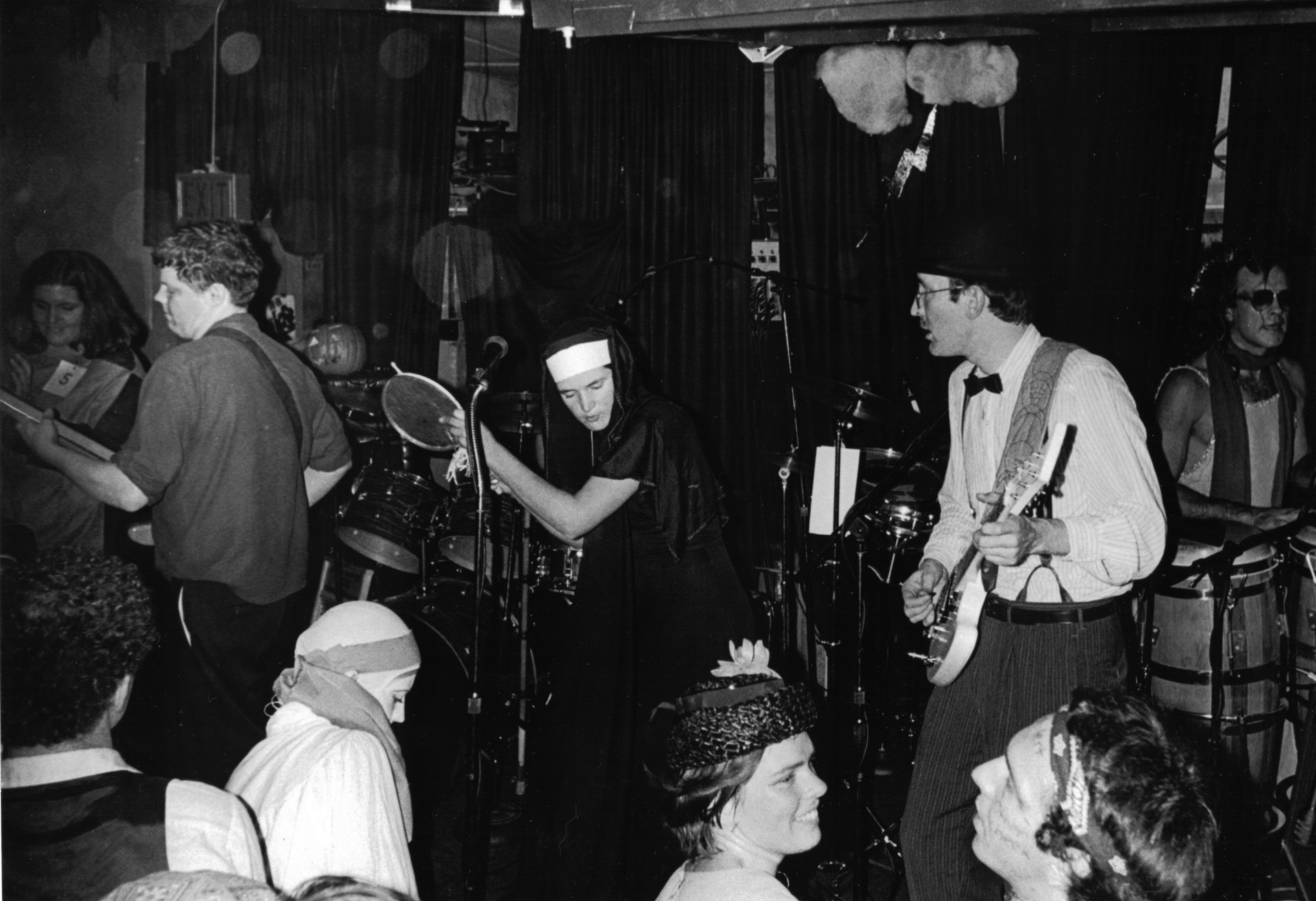 The Squalls by unknown photographer. Halloween 1982 at the 40 Watt. Left to Right Diana Torell, Alan Walsh, Mig Little, Bob Hay, Ken Starratt. Drummer not seen, but probably Mark Cooper Smith. Photo courtesy of Bob Hay.